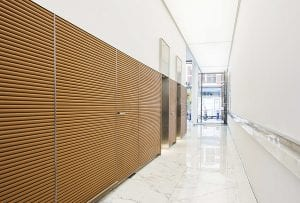 Davidson fluted leather wall corridor