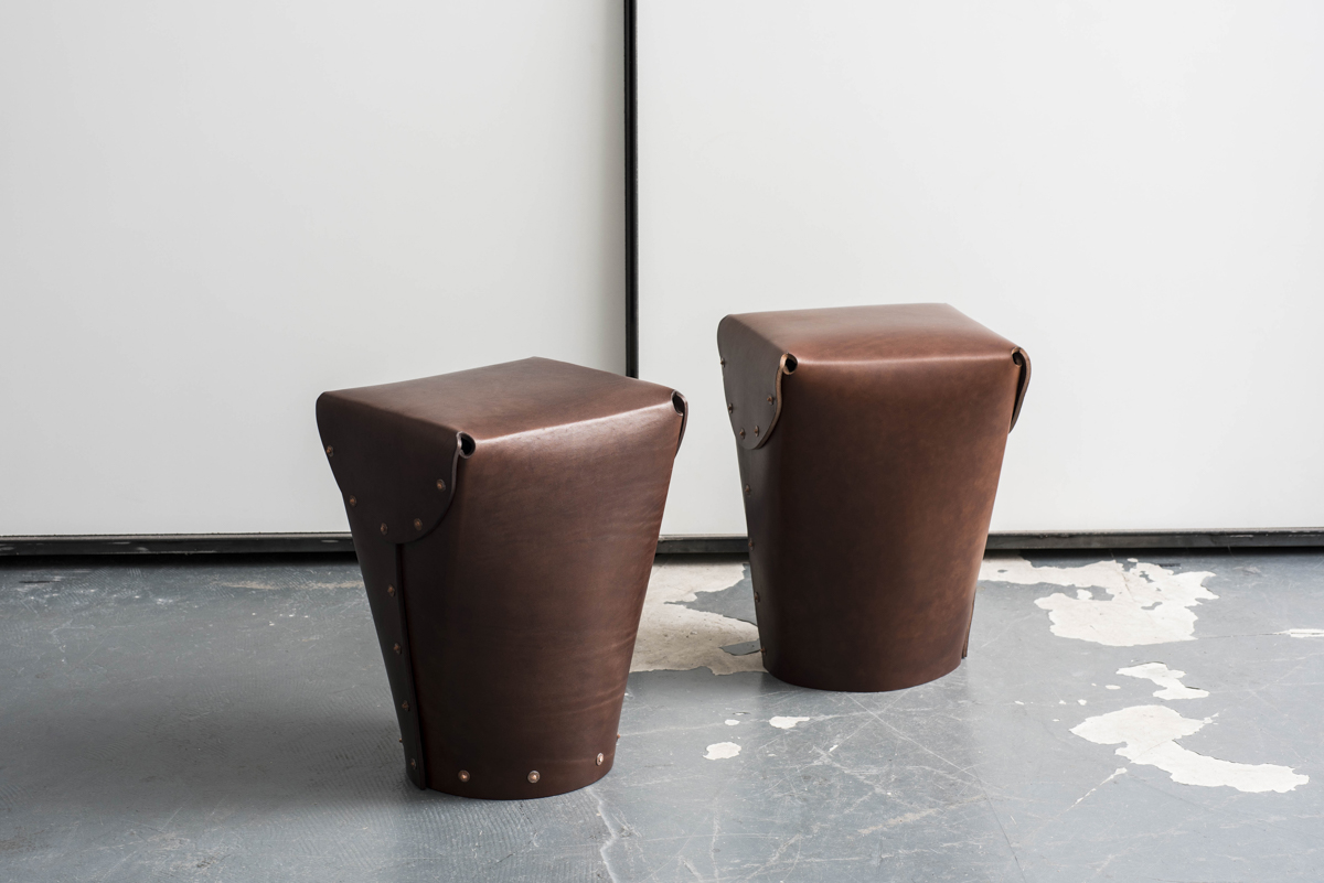 Two leather stools.