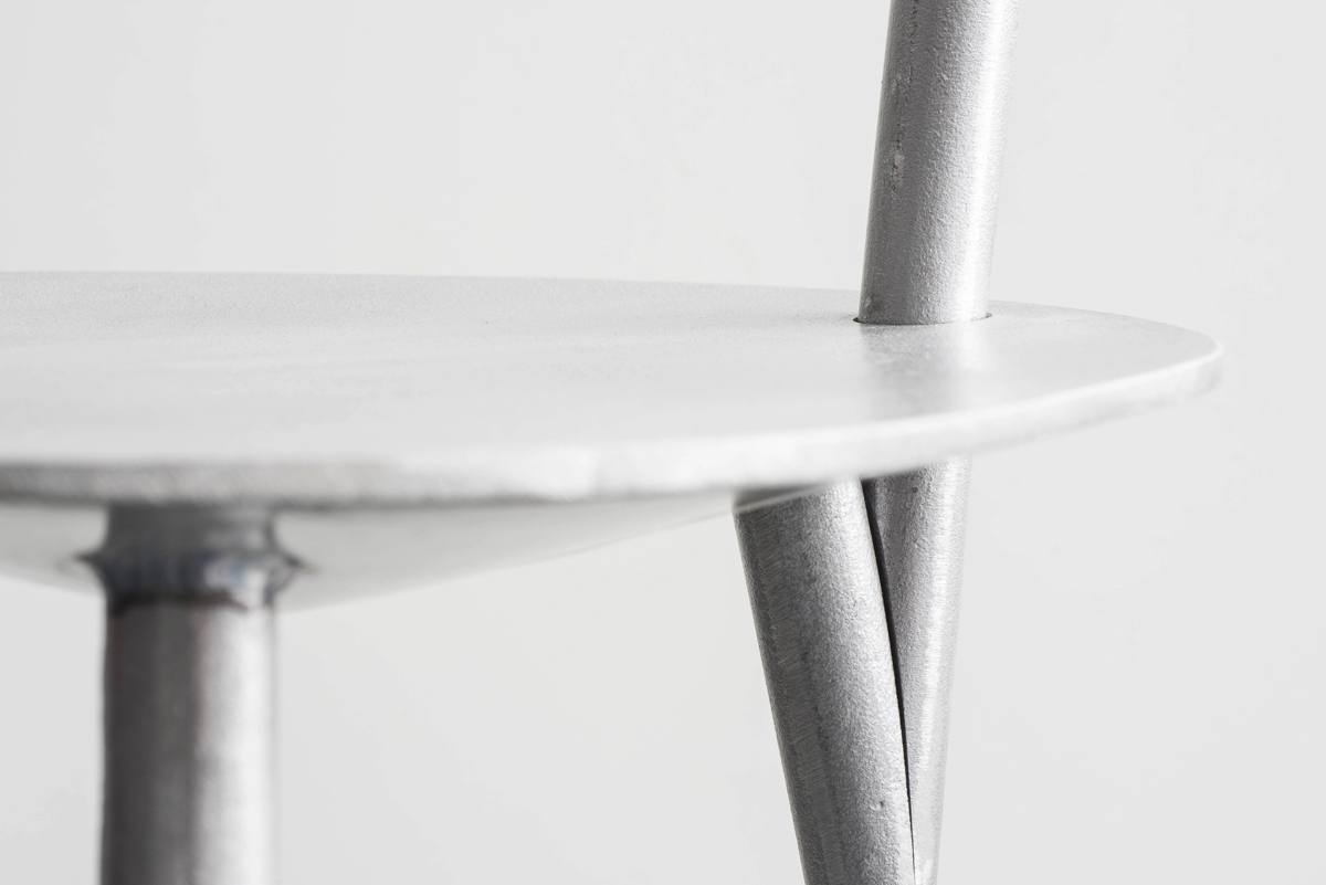 A close-up of an aluminium chair.