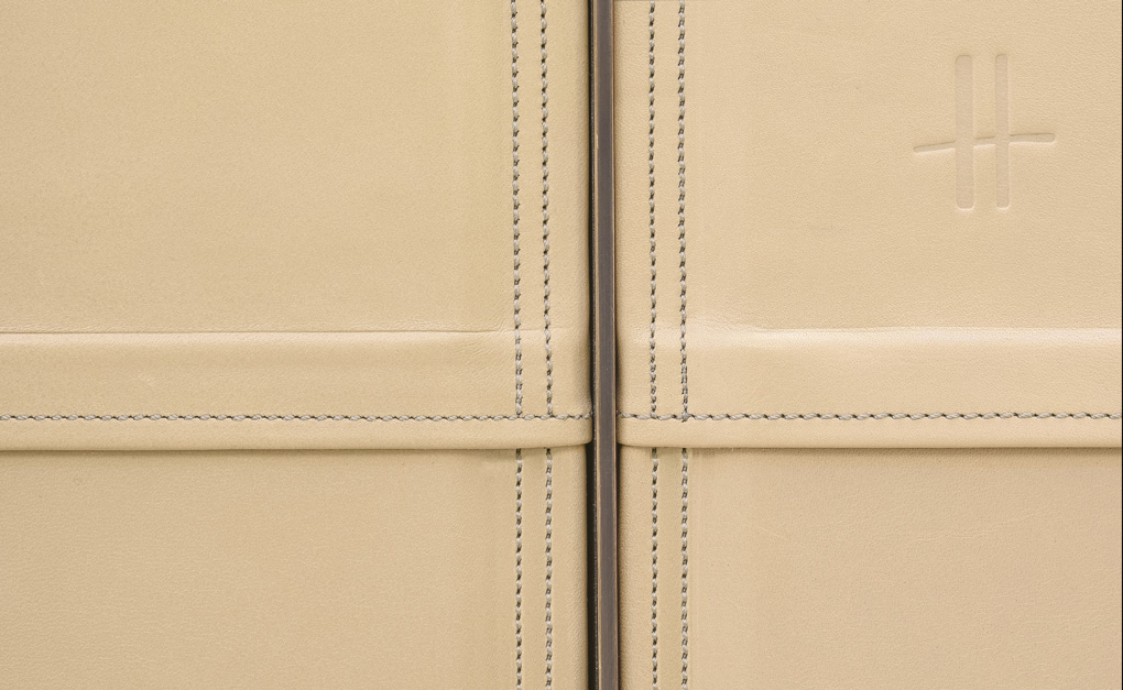 Stitching details of cream leather wall panels in Harrods Fine Watch Department