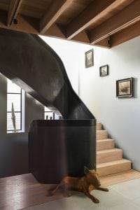 Modern steel balustrade with leather wrapped handrail