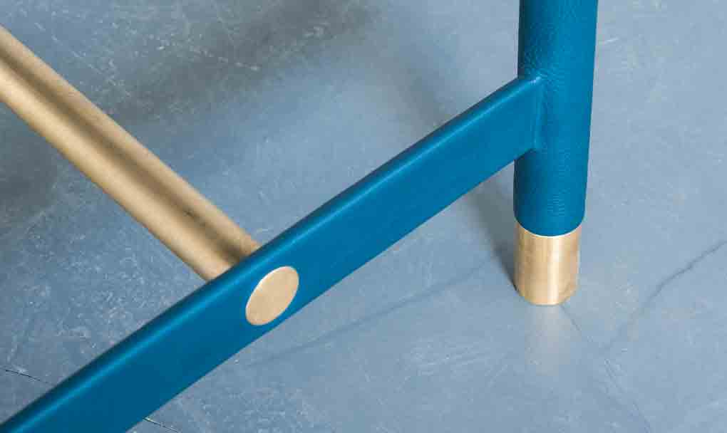 A look at the golden and blue legs of the brass frame.