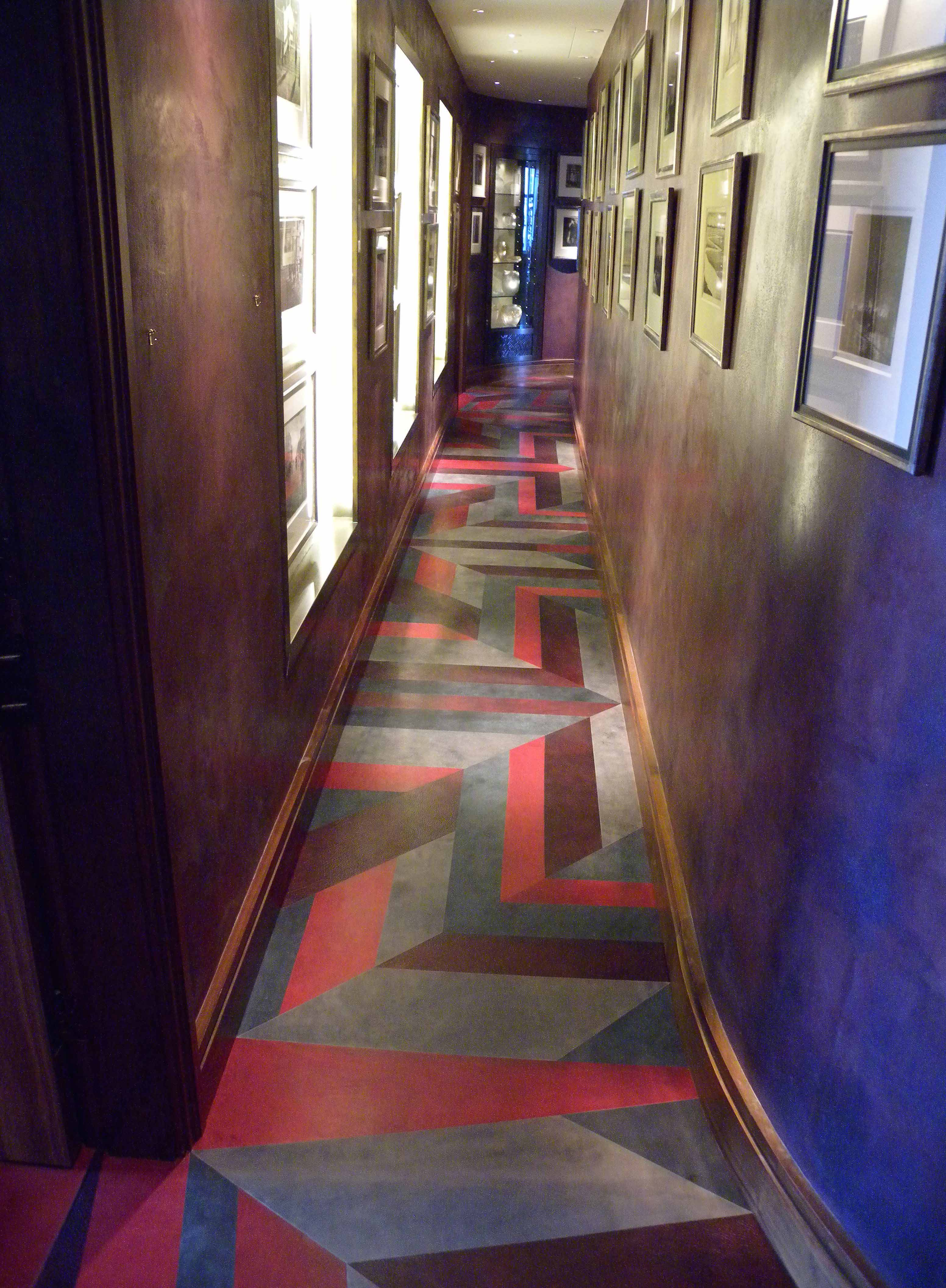 The mosaic floor of the hallway, complete with three vegetable-tanned leathers.