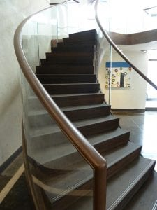 Curved leather and glass balustrade